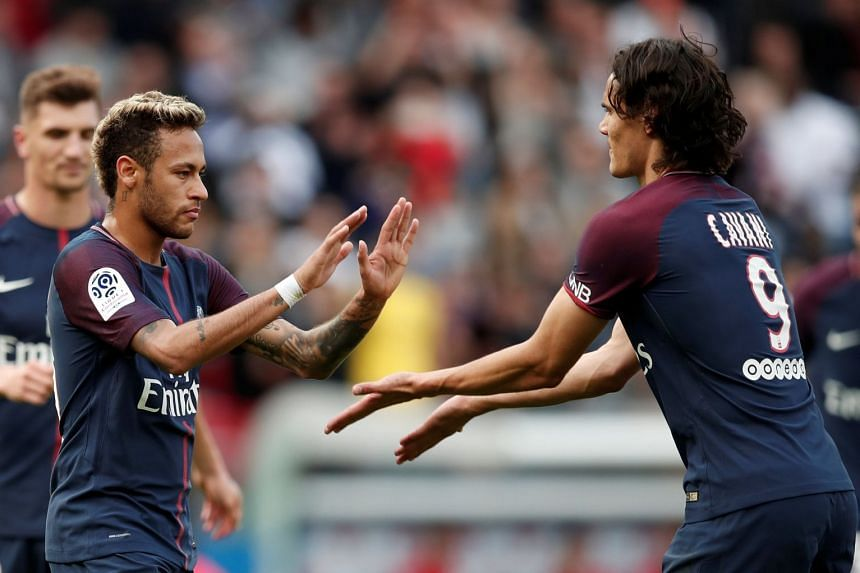 Neymar celebrates scoring PSG's fourth goal with Edinson Cavani.