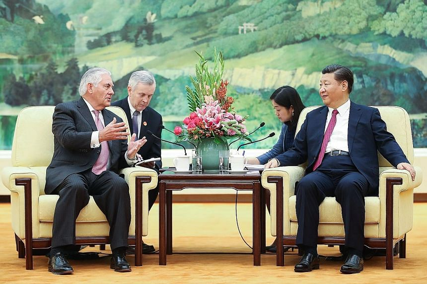 US Secretary of State Rex Tillerson with Chinese President Xi Jinping at the Great Hall of the People in Beijing yesterday. Mr Tillerson met with senior Chinese officials to lay the groundwork for Mr Donald Trump's trip.