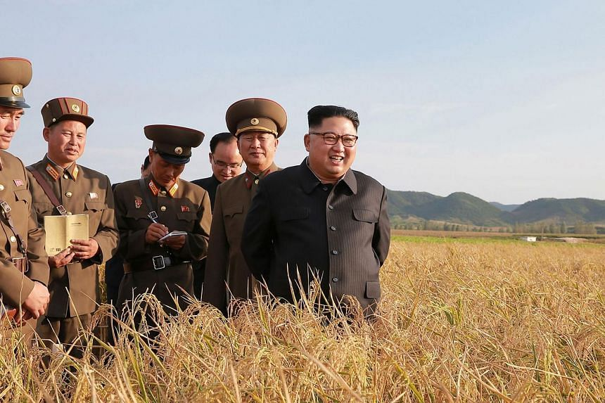 North Korean leader Kim Jong Un (right) visiting Farm No. 1116 under Korean People's Army Unit 810 at an undisclosed location, in an undated picture released from the North's official Korean Central News Agency. US Secretary of State Rex Tillerson sa