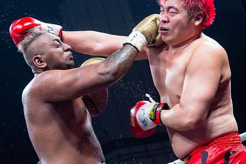 Pradip Subramanian and Steven Lim facing off during the AFC match at Marina Bay Sands last Saturday.