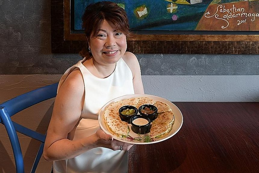 Vivian Wee, director of Mexican restaurant Comida Mexicana in East Coast Road, with a plate of crab and avocado quesadillas.