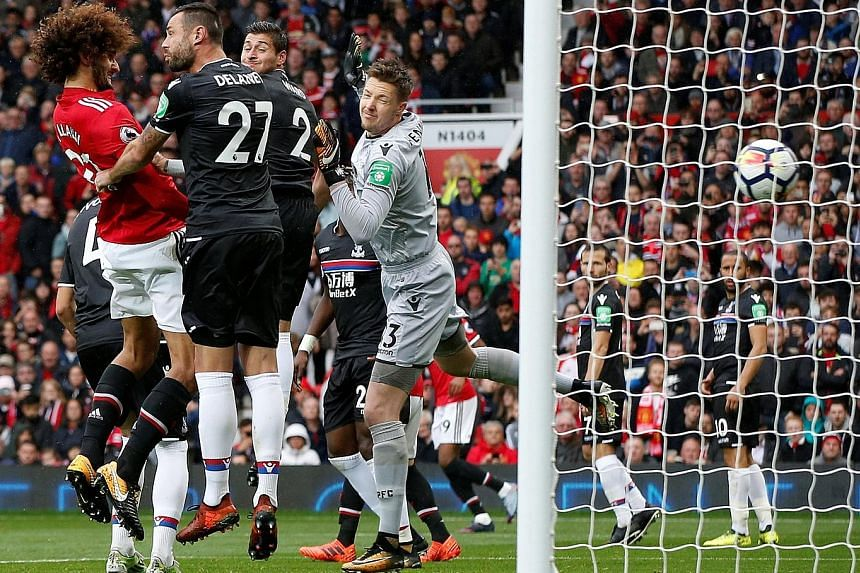 Marouane Fellaini scoring his second goal of the Premier League match, and his team's third, against rock-bottom Crystal Palace at Old Trafford yesterday. It was the seventh time United had scored four in a game this season.