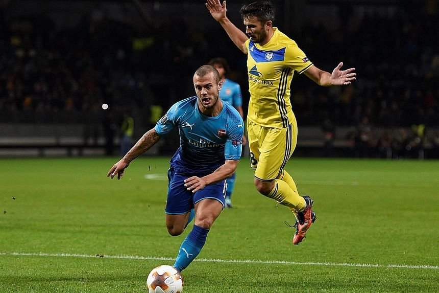 Jack Wilshere getting the better of Bate Borisov's Alyaksandr Valadzko in Thursday's Europa Cup match. Wilshere gave a tantalising glimpse of his ability in Arsenal's 4-2 victory.