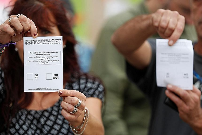 The ballots of the banned independence referendum that is set to take place today in Barcelona. Organisers have urged voters to arrive at 5am at polling stations and show peaceful resistance to police action. Madrid has sent thousands of police offic