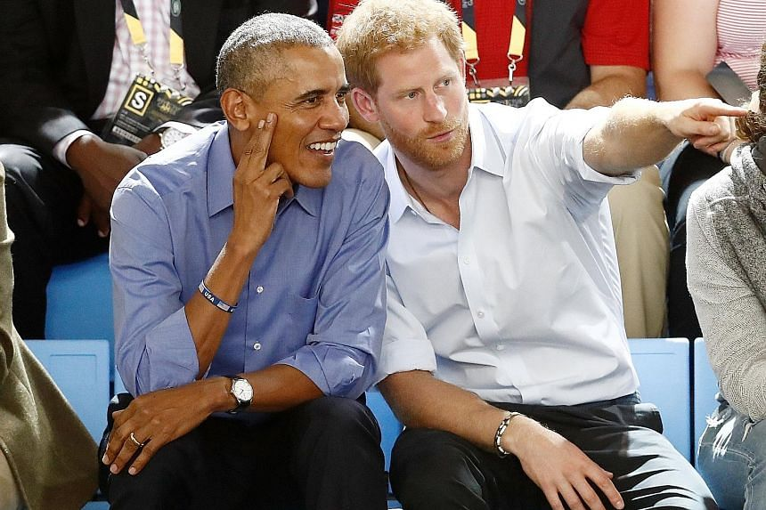 Britain's Prince Harry watching a wheelchair basketball event with former United States president Barack Obama at the Invictus Games in Toronto, Canada, last Friday. The Invictus Games, the brainchild of Prince Harry, is an international Paralympic-s