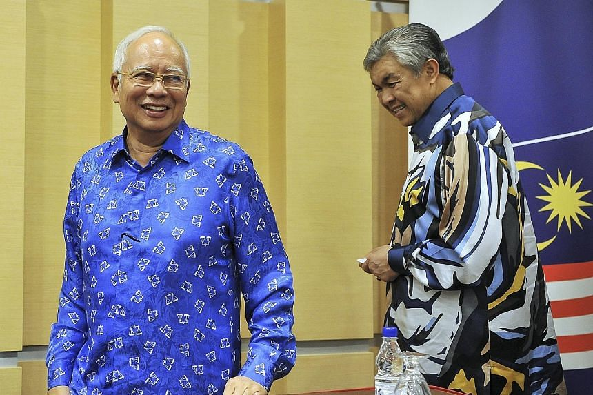 Umno president Najib Razak and deputy president Ahmad Zahid Hamidi leaving an Umno meeting last Friday. Datuk Seri Najib had hoped to burnish his image with two major events last month - a meeting with US President Donald Trump and the return of a fo