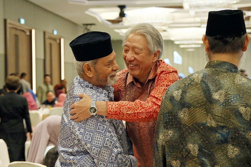 Deputy Prime Minister Teo Chee Hean greeting retired Navy serviceman Mohd Salleh Khan Surattee, 80, who used to serve in the Navy with Mr Teo, at the event yesterday.