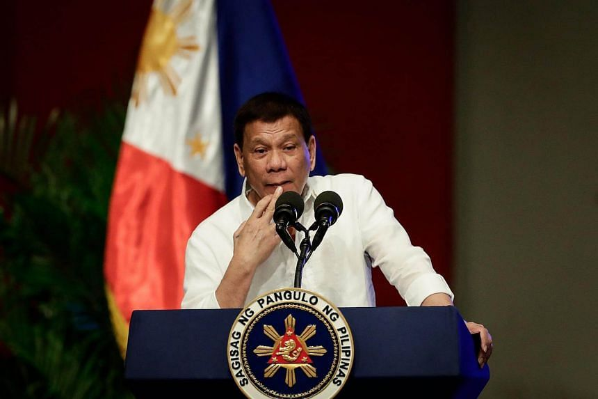Philippine President Rodrigo Duterte gestures during his speech in Pasay City, Philippines, on Sept 26, 2017.