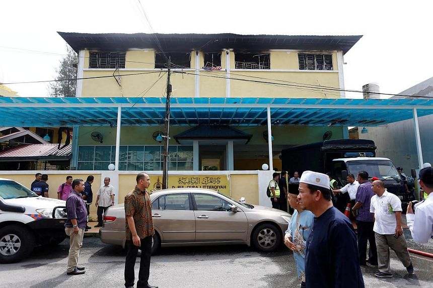 The aftermath of the fire at the religious school Darul Quran Ittifaqiyah on Sept 14, 2017.