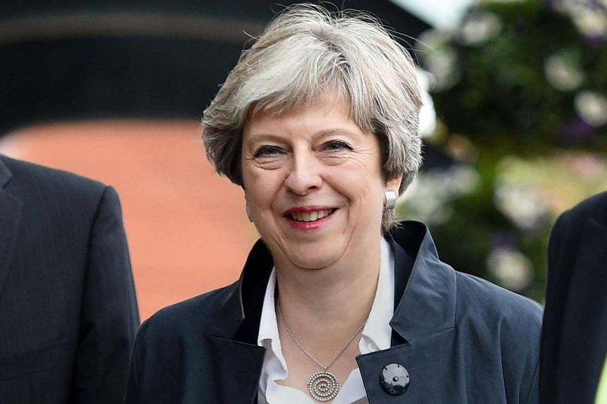 Britain's Prime Minister Theresa May arrives at the Midland Hotel in Manchester on Sept 30, 2017.