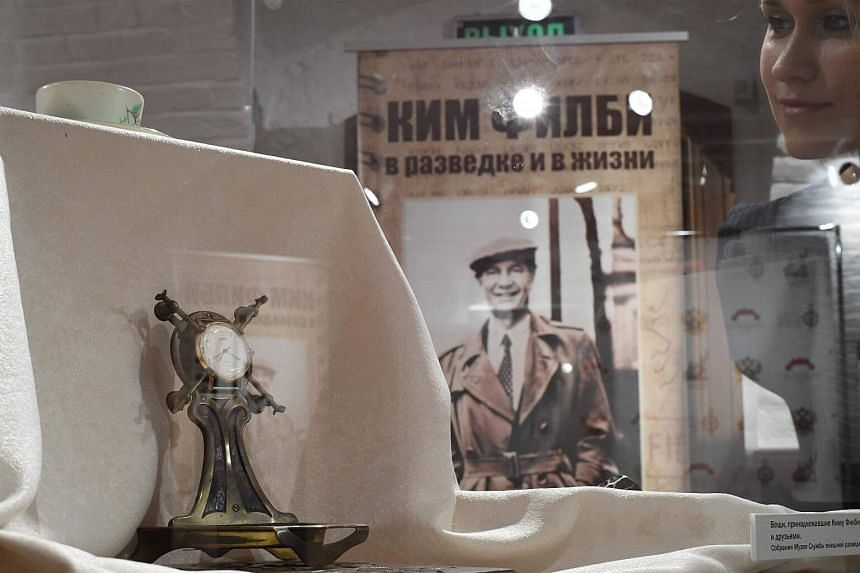 A woman looking at personal belongings of British KGB agent Kim Philby during the exhibition Kim Philby in espionage and in life at the Russian Historical Society on Sept 29, 2017.