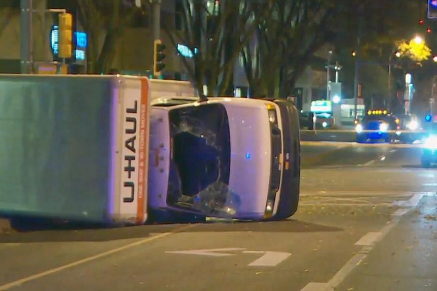 Canadian police officers arrested the driver of a U-Haul van, after he ploughed into several pedestrians while evading police, in Edmonton on Oct 1, 2017. The man is believed to have earlier attacked a police officer in what is being investigated as