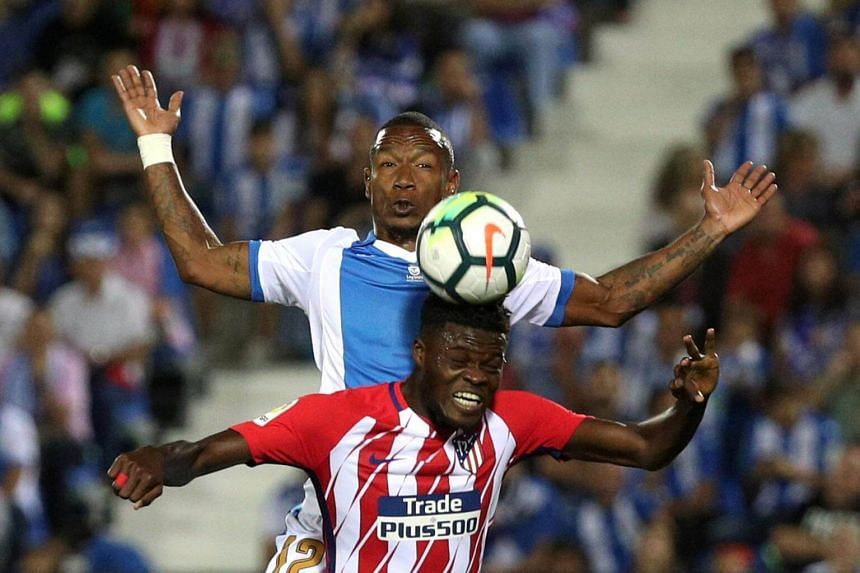 Atletico Madrid's Thomas in action with Leganes' Claudio Beauvue.  Atletico Madrid's goalless draw at Leganes on Saturday dropped them to third in the La Liga  standings.