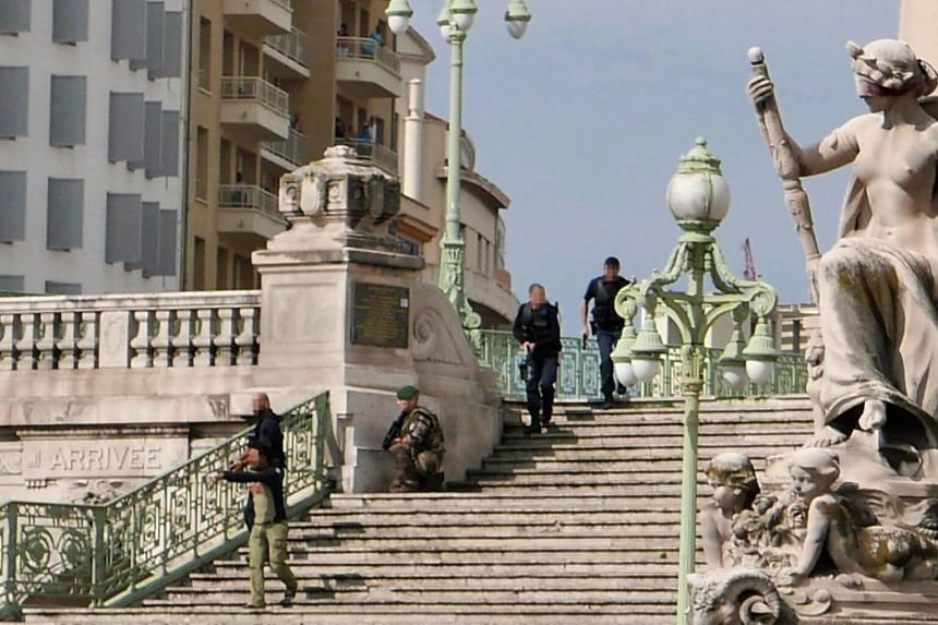 Armed French police officers on the steps leading to Saint-Charles station, after a stabbing incident left two people dead, in Marseille on Oct 1, 2017.