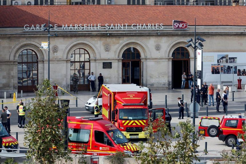 French emergency services personnel and vehicles attending to a stabbing incident at the Saint-Charles station in Marseille, on Oct 1, 2017.
