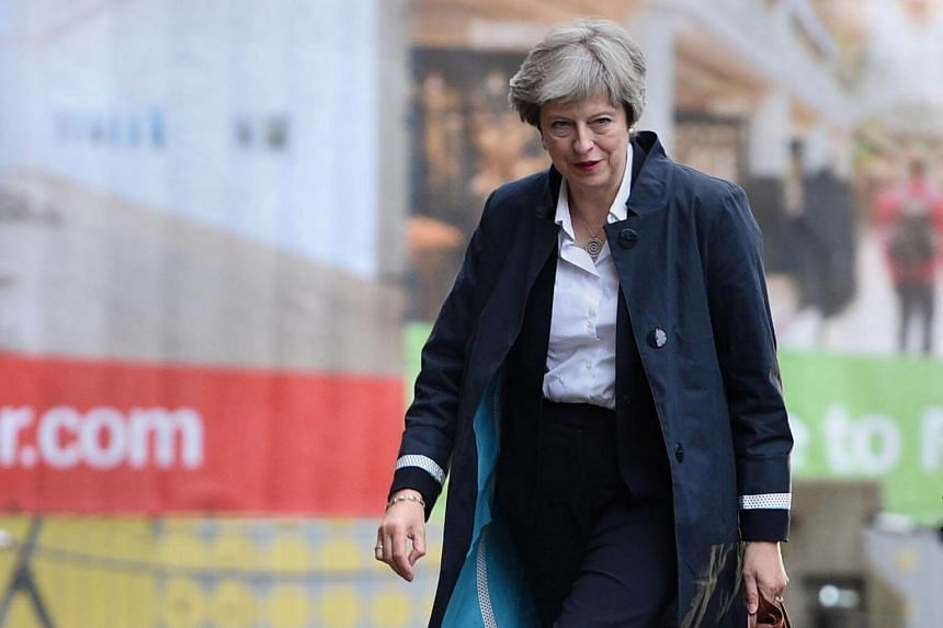 British Prime Minister Theresa May said she had listened to the message given by the election in which she lost her party's majority in parliament.