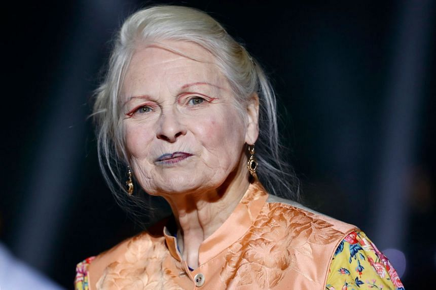 Fashion designer Vivienne Westwood acknowledges the audience at the end of her husband's show.