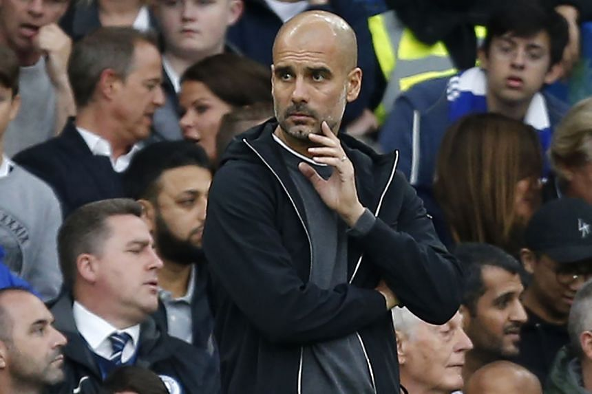 Guardiola watches from the touchline.