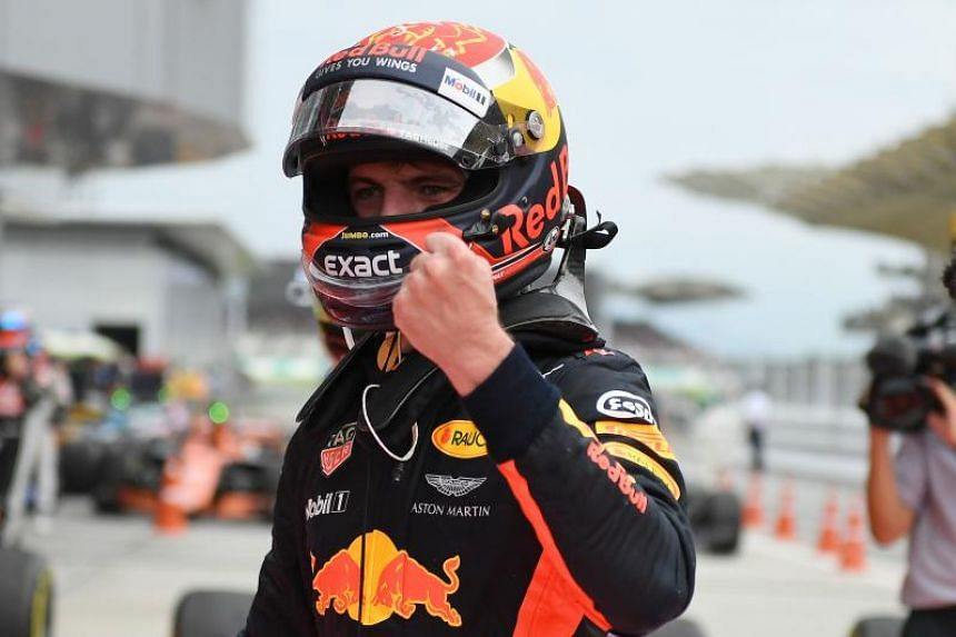 Red Bull's Dutch driver Max Verstappen celebrates winning the Malaysia Grand Prix in Sepang.