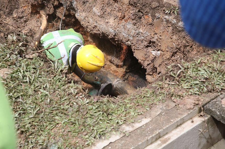 After turning off the water supply, workers replaced the malfunctioning pipe with a new one.