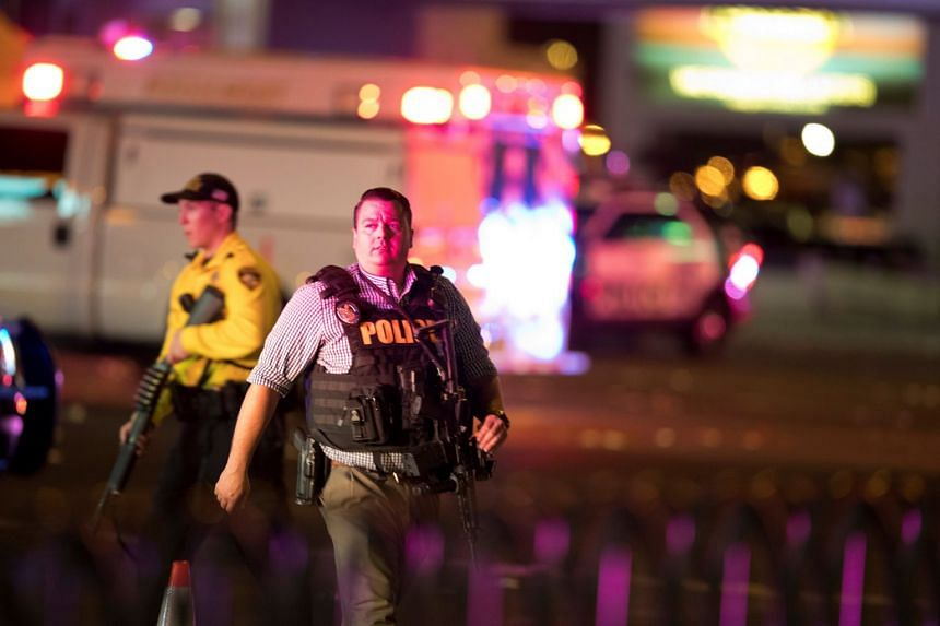Law enforcement officers show up after a mass shooting during a music festival in Las Vegas, US, on Oct 2, 2017.