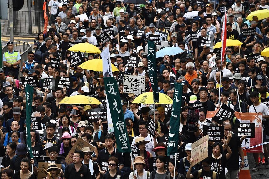 Demonstrators in Hong Kong taking to the streets for a pro-democracy rally yesterday, which was also China's national day.