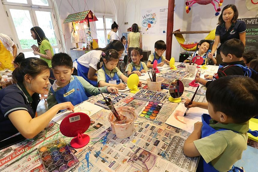 "In the two-hour art sessions, the children take part in activities such as drawing portraits and making ""pizza"" out of art materials. The workshop series takes on the format of a dinner party, hence its name - Who Is Coming To Dinner? About 800 child"