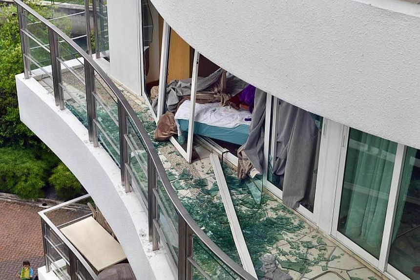 The shattered remains of glass doors and windows of the fifth-floor Cote D'Azur apartment's balcony. The incident is believed to have involved the rupture of a storage water heater.