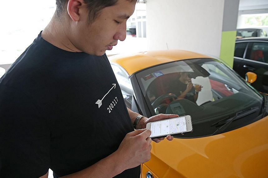Mr Eugene Tay, a director of a trading firm, trying out the Parking.sg app yesterday. The 27-year-old said that he found it easy to navigate the app, but his elderly parents, who do not own smartphones, would still have to rely on parking coupons.