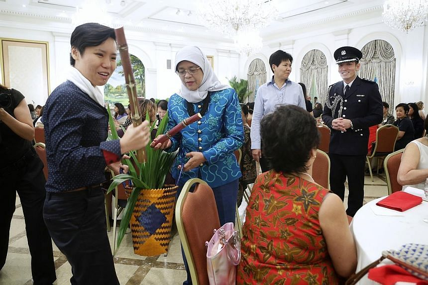 Sugar cane, pandan leaves and a banana cake. These were some of the items Ms Manda Foo (holding sugar cane) and Mrs Ivy Singh-Lim of the Gentle Warriors' Trust gave President Halimah Yacob yesterday at the Istana, where the President hosted a lunch f