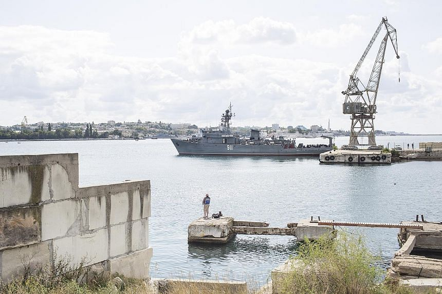 A Russian Navy vessel in the port city of Sevastopol in Crimea. Annexed by the Russian Empire in 1783, the territory became part of Ukraine in 1954. In the eyes of many Russians, President Vlamimir Putin proclaimed his readiness to stand up to the We