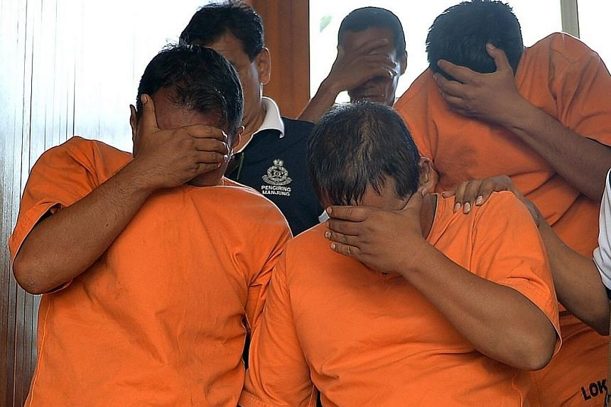 The three suspects were taken to a magistrate's court yesterday to be remanded for further investigations. Defence Minister Hishammuddin Hussein has instructed the navy to give the police full cooperation.
