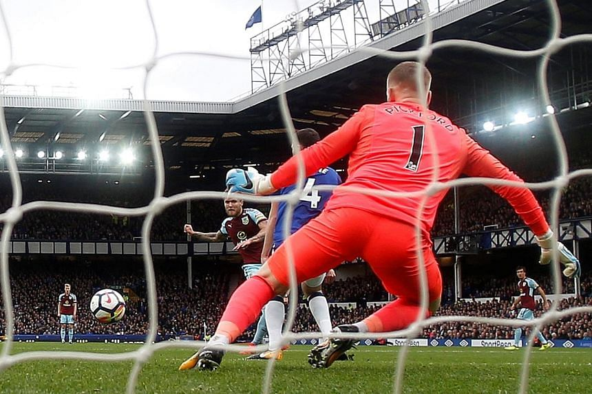 Burnley midfielder Jeff Hendrick capping off a 24-pass move by beating Everton goalkeeper Jordan Pickford in a Premier League match at Goodison Park yesterday.