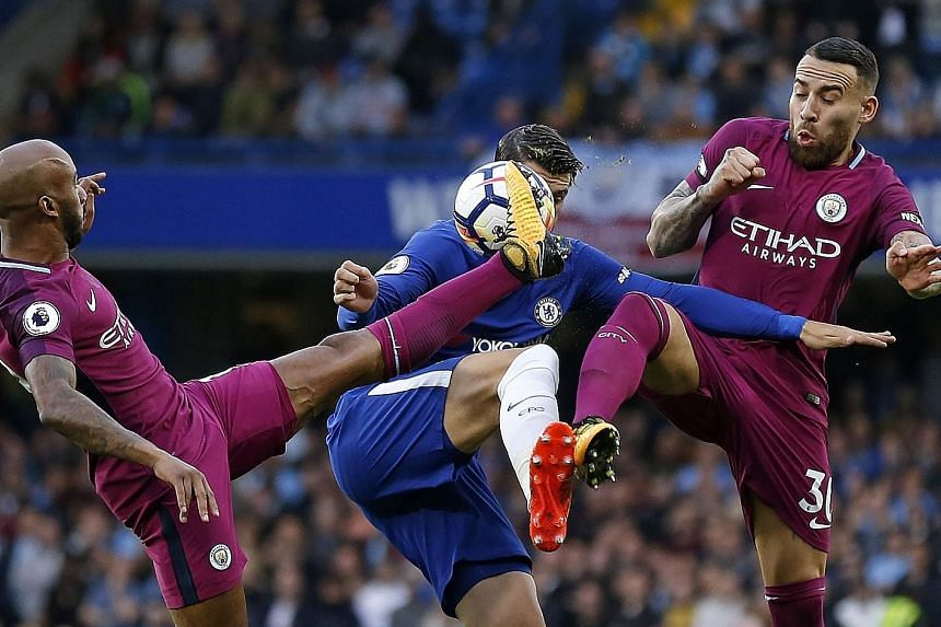 Above: Chelsea striker Alvaro Morata (centre) takes on Man City's Fabian Delph (left) and Nicolas Otamendi at Stamford Bridge on Saturday. City returned to the top of the Premier League table with the 1-0 win against the reigning champions.