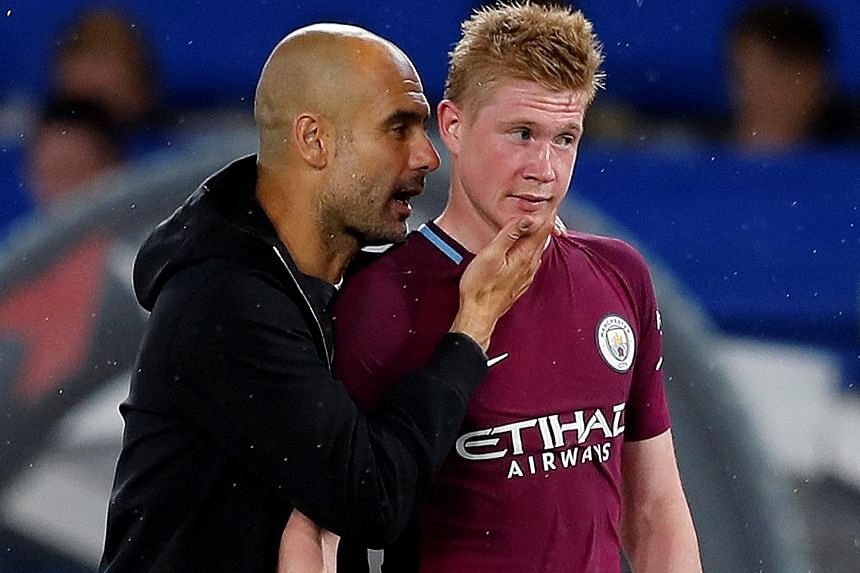 "Manchester City manager Pep Guardiola with Kevin de Bruyne. The Belgian, who scored the only goal of the match, was hailed by Antonio Conte as a ""complete player""."