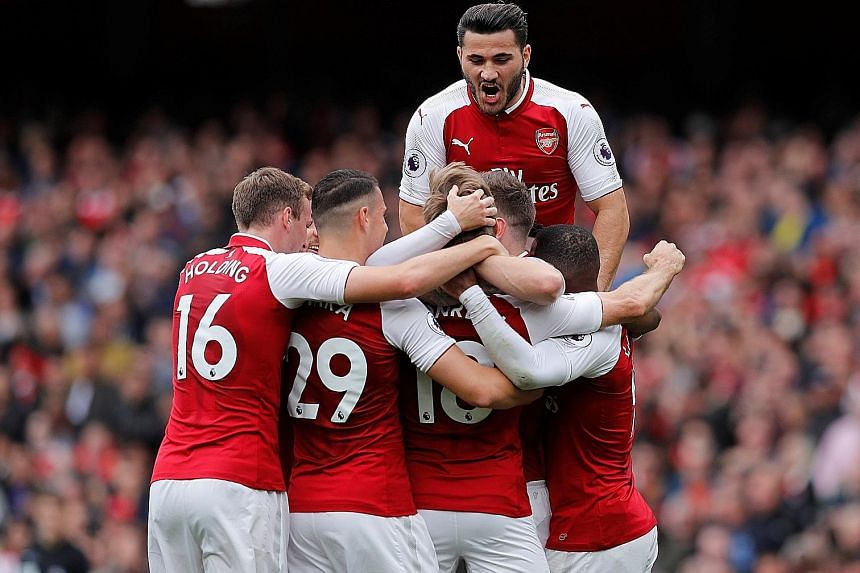 Arsenal's Nacho Monreal (No. 18) celebrating his first Premier League goal in more than four years with his teammates after opening the scoring on 16 minutes. The 31-year-old Spanish defender scored his first Premier League goal 1,660 days earlier -