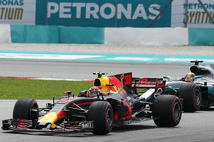 Red Bull driver Max Verstappen gliding up the inside at turn one to overtake Mercedes' pole-sitter Lewis Hamilton on lap four of yesterday's Malaysian Grand Prix.