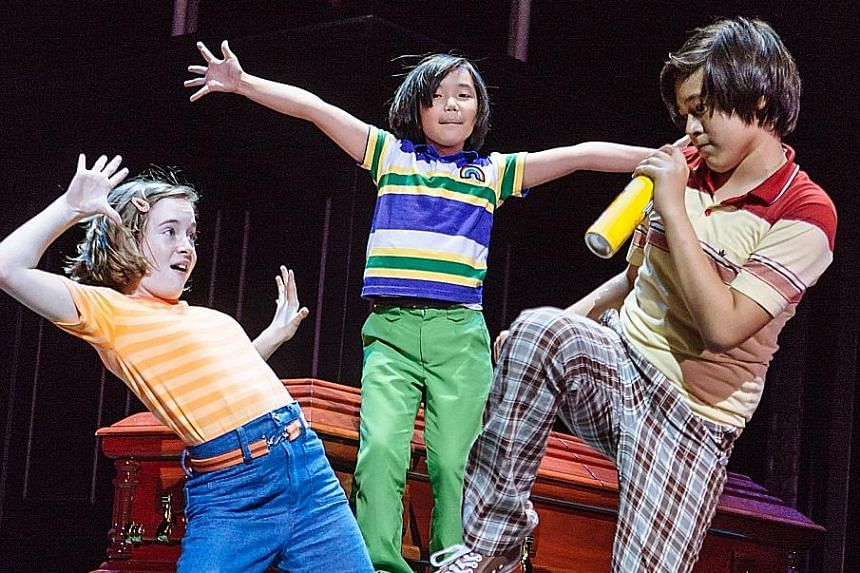 (From left) Elly Gaskell, Aria Zhang and Bjorn Haakenson bopped atop caskets in the tender and real Fun Home.