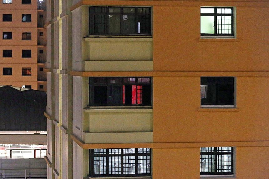 Over a span of two hours, The Straits Times spotted at least five men who looked to be between the ages of 20 and 60 entering the unit, which is in an HDB block about five minutes from Pioneer MRT station.