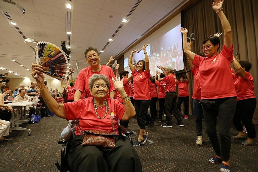 Madam Chan Ah Peng (in wheelchair), 80, taking part in a dance performance with others from O'Joy Care Services yesterday.