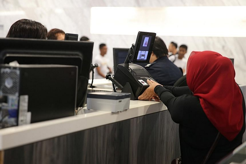 Thumbprint-scanning at the Singapore Cruise Centre. Car drivers and passengers passing through the Tuas and Woodlands checkpoints must now also have their thumbprints scanned for security reasons.