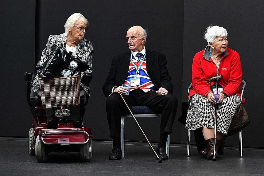 Delegates at the Conservative Party's annual conference in Manchester, which started yesterday. The conference is the first gathering of party members and lawmakers since Mrs Theresa May's disastrous decision to call a snap election that cost the par