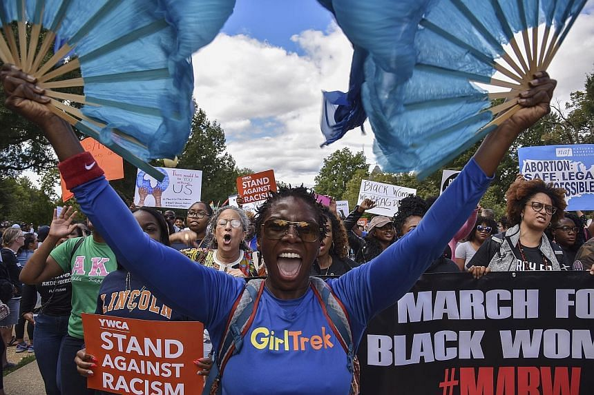 Two separate rallies converged on the weekend in Lincoln Park, a picnic-and-birthday-party plot nestled in the heart of the gentrified eastern part of the Capitol Hill neighbourhood in Washington. 	Thousands of anti-racism marchers rallied last Satur