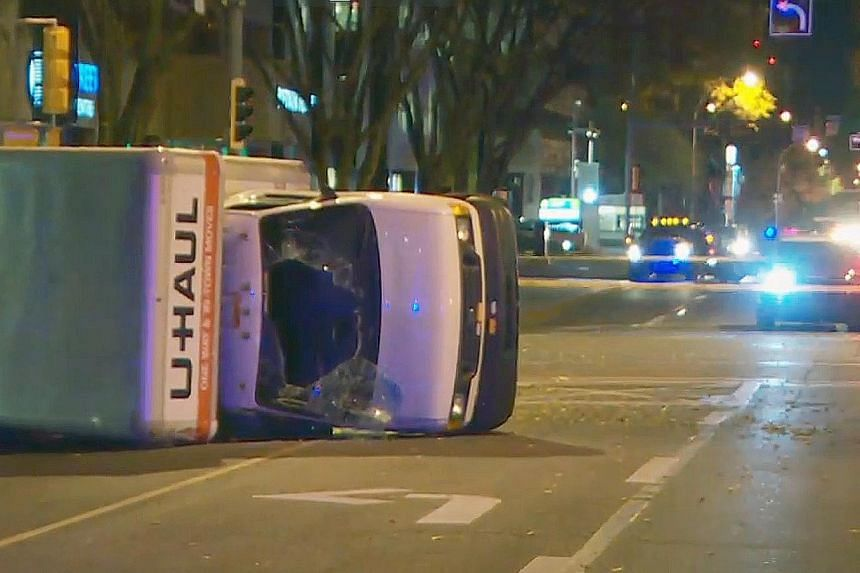 Canadian police have arrested a man suspected of stabbing an officer and injuring several pedestrians last Saturday. The driver of a U-Haul truck was arrested after it flipped over, ending a high-speed chase through Edmonton in Alberta province.