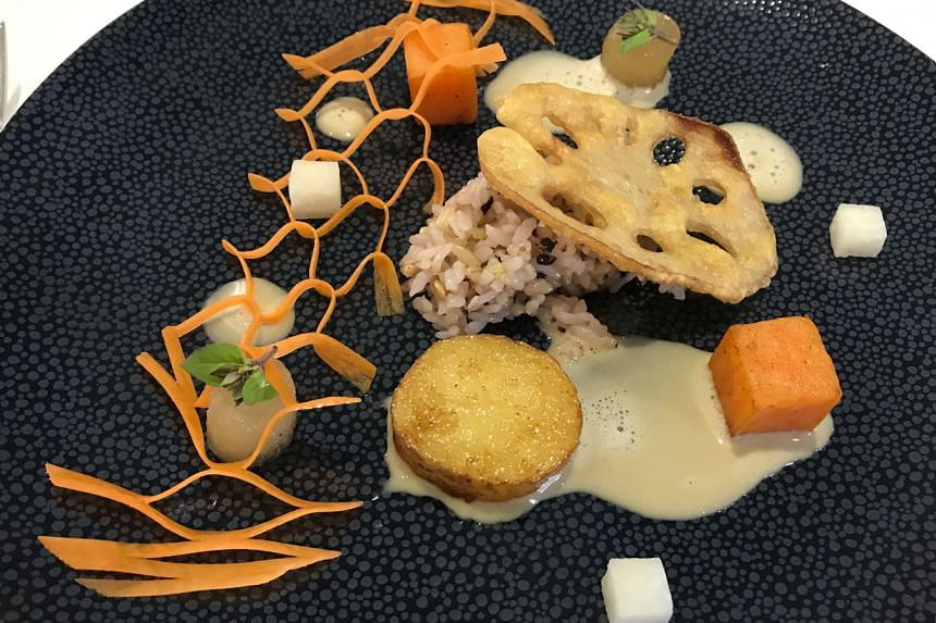 Art of roots, a vegetarian dish with sautEed multigrain rice and butter ginseng sauce.