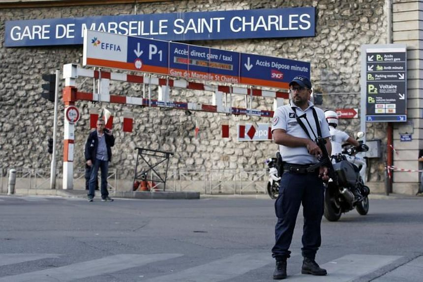 Police officers guard the train station of Saint Charles in Marseille, France, on Oct 1, 2017.