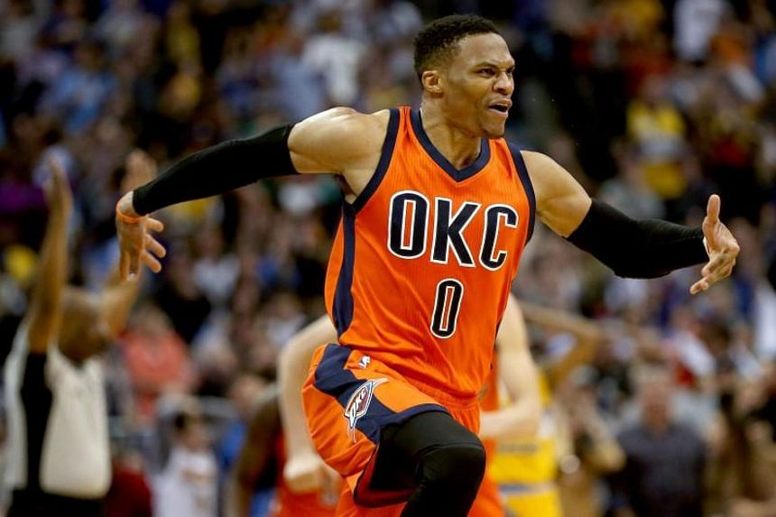 Russell Westbrook celebrates after scoring a game-winning, three-point shot at the buzzer against the Denver Nuggets at the in Denver, Colorado on April 9, 2017.