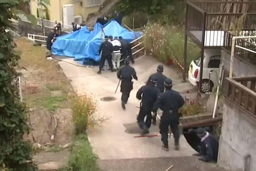 Officers trying to capture the wild boar at a residential area in southern Japan.