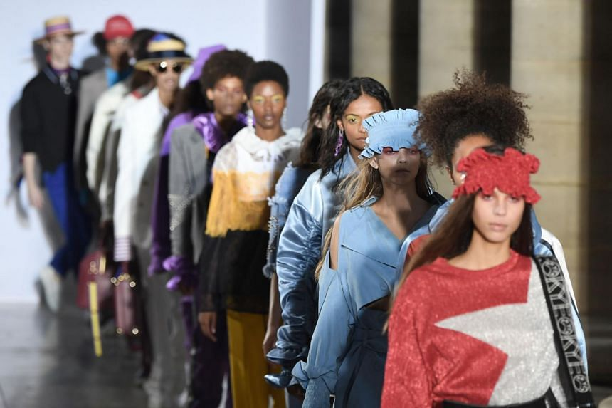Models present creations for the K Fashion Project during the women's 2018 Spring/Summer ready-to-wear collection fashion show in Paris, on Sept 30, 2017.