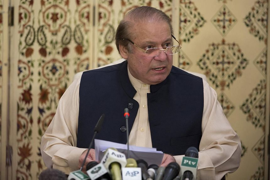 Former Prime Minister Nawaz Sharif talks with journalists after he appeared before an accountability court, in Islamabad, Pakistan, on Sept 26, 2017.